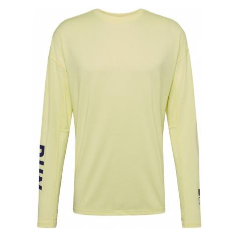 REEBOK Koszulka funkcyjna czarny / jasnożółty