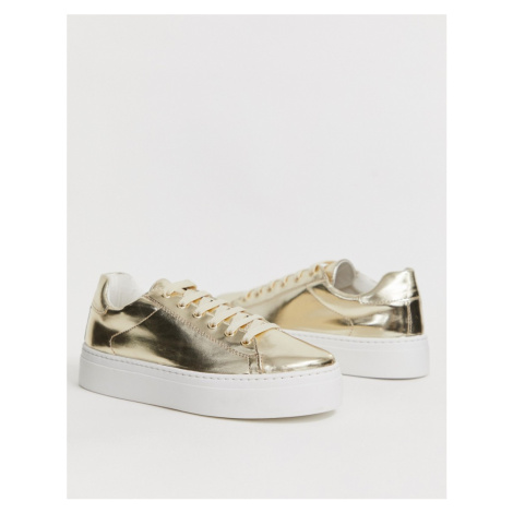ASOS DESIGN Day Light chunky flatform lace up trainers in gold