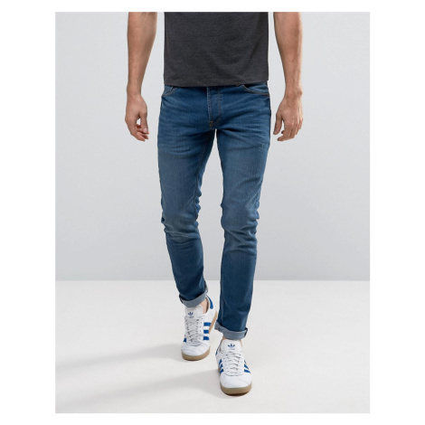 Solid Slim Fit Jeans In Mid Blue Wash With Stretch