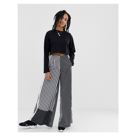 Adidas Originals mixed stripe popper pants in black and white