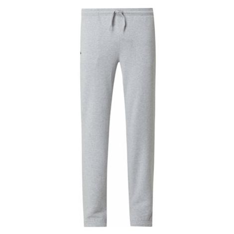Spodnie dresowe z mieszanki bawełny Lacoste
