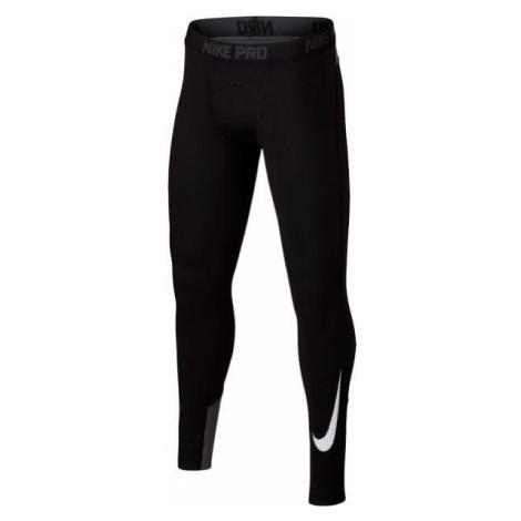 Nike WM TGHT GFX czarny S - Legginsy sportowe chłopięce
