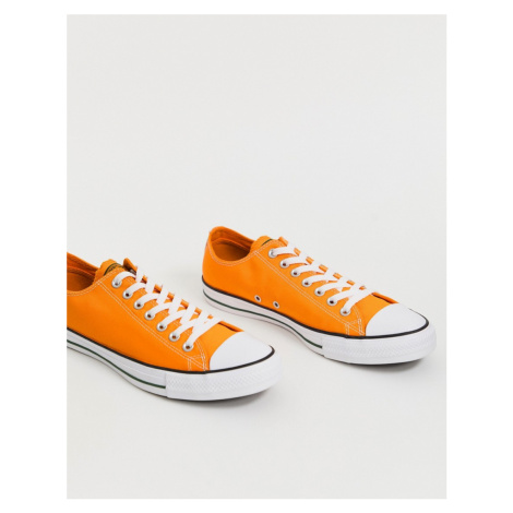 Converse All Star low Chuck Taylor plimsolls in yellow