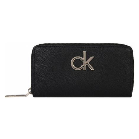 Damskie portfele, etui na dokumenty i wizytowniki Calvin Klein