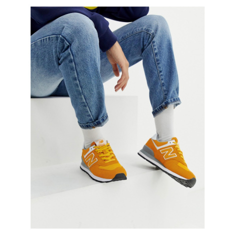 New Balance 574 yellow sude trainers
