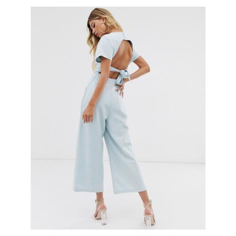 ASOS DESIGN denim button through jumpsuit with open back in midwash blue