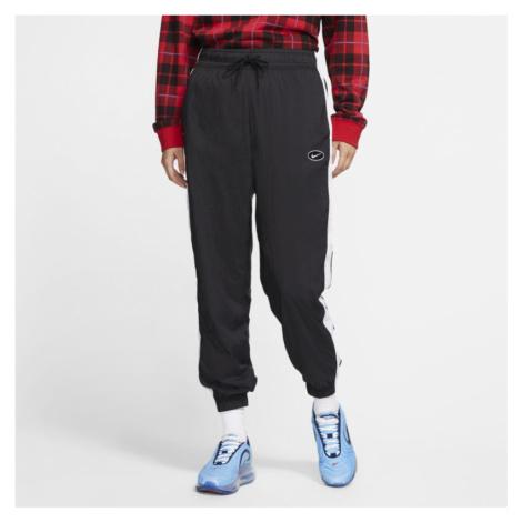 Spodnie z tkaniny z logo Swoosh Nike Sportswear - Czerń