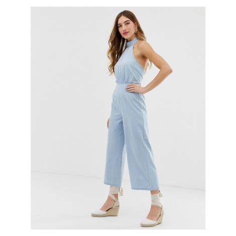 ASOS DESIGN denim halterneck jumpsuit with wide leg in lightwash blue