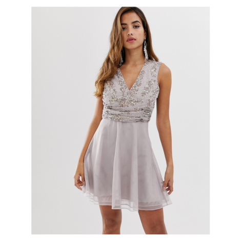ASOS DESIGN mini dress with pearl and sequin embellished wrap bodice