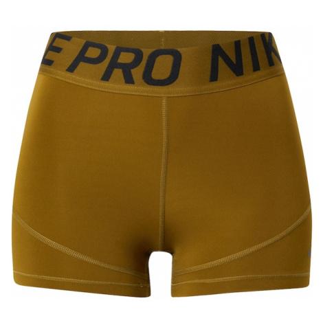 NIKE Spodnie sportowe oliwkowy / ciemny niebieski