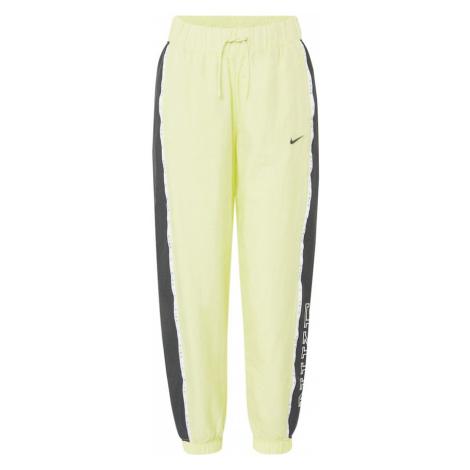 Nike Sportswear Spodnie 'Piping' żółty