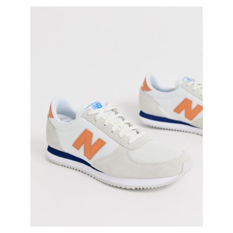 New Balance 220 trainers in cream & orange