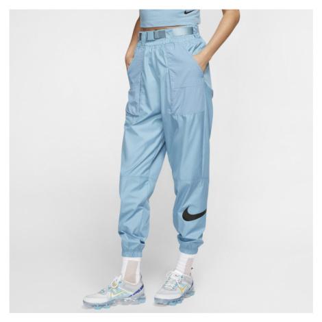 Damskie spodnie z tkaniny z logo Swoosh Nike Sportswear - Niebieski
