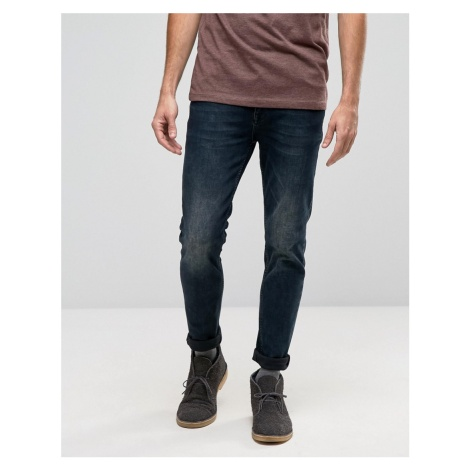 ASOS DESIGN skinny jeans in blue black wash