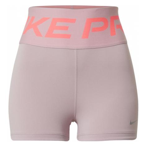NIKE Spodnie sportowe różowy pudrowy / koralowy
