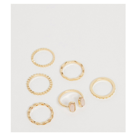 ASOS DESIGN Curve pack of 6 rings in engraved design with pink stone in gold tone