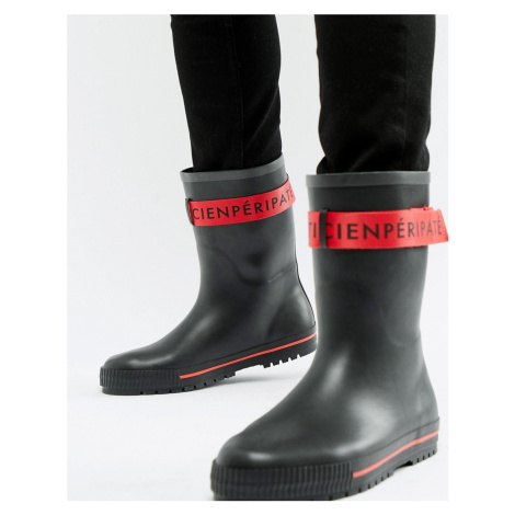 ASOS DESIGN wellies in black with red tape detail