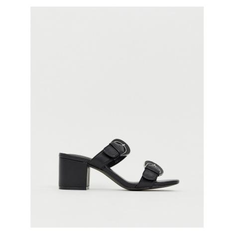 E8 by Miista black leather mid block heel buckle detail sandals