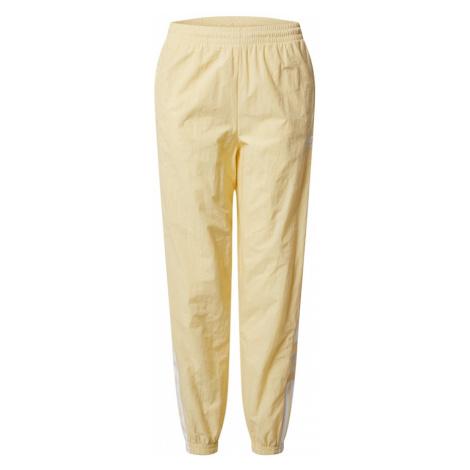 ADIDAS ORIGINALS Spodnie 'Lock Up' pastelowo-żółty