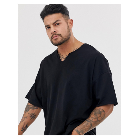 ASOS DESIGN oversized t-shirt with raw notch neck in black