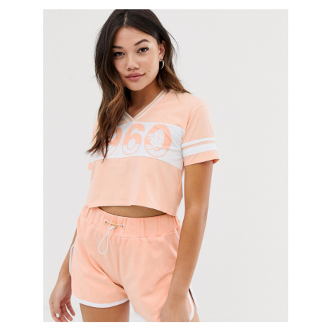 Lonsdale cropped varsity v neck t-shirt in peach