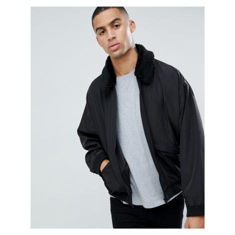 ASOS DESIGN oversized bomber jacket in black with borg collar