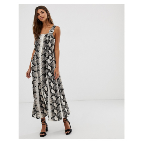 ASOS DESIGN dungaree maxi dress with buckles in snake print