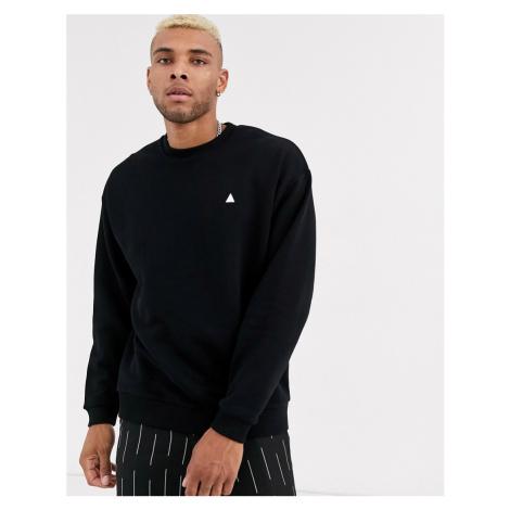 ASOS DESIGN oversized sweatshirt in black with triangle