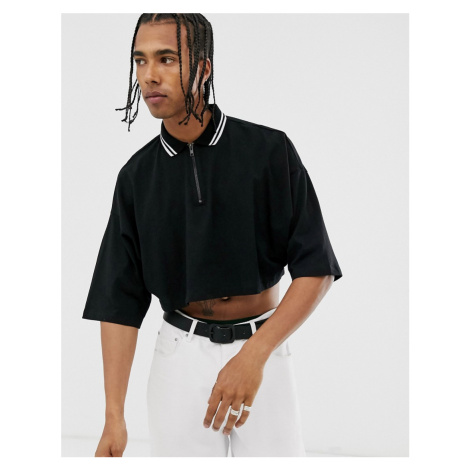 ASOS DESIGN cropped oversized polo shirt with half sleeve and zip neck and tipping in black