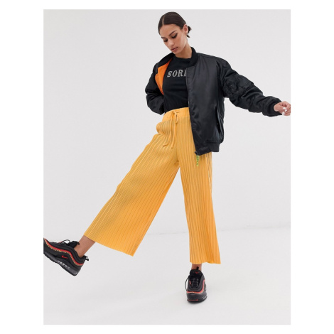 Bershka wide leg drawstring trousers in orange