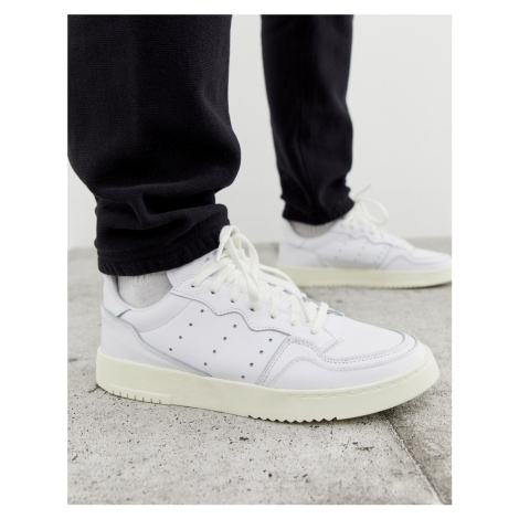 Adidas Originals SuperCourt trainers in white X home of classics edition