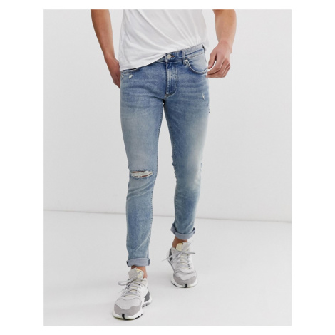River Island super skinny jeans with rip & repair in light blue wash