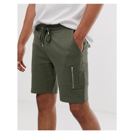 ASOS DESIGN skinny jersey shorts with MA1 pocket in khaki