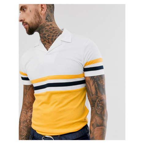 ASOS DESIGN polo shirt with revere collar with contrast body panels in yellow