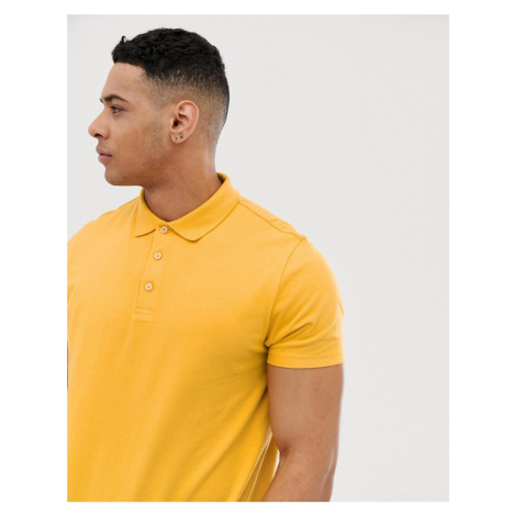 ASOS DESIGN polo in jersey in yellow