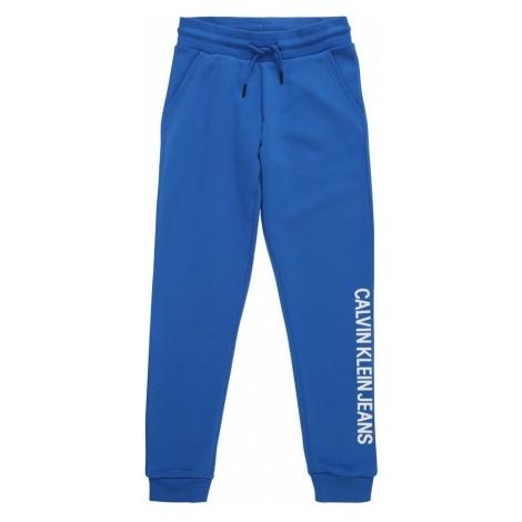 Calvin Klein Jeans Spodnie 'LOGO COTTON TERRY SWEATPANTS' niebieski