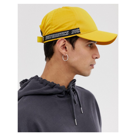 ASOS DESIGN baseball cap in yellow nylon with taping