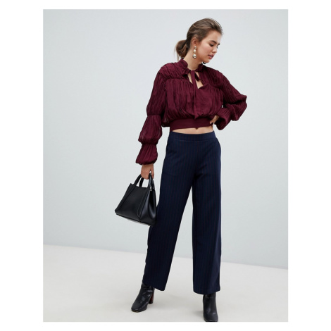 B.Young pinstripe trousers