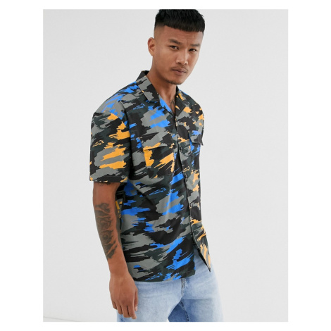 ASOS DESIGN relaxed fit camo shirt with chest pockets