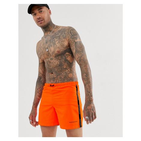 Good For Nothing swim shorts in orange with logo taping