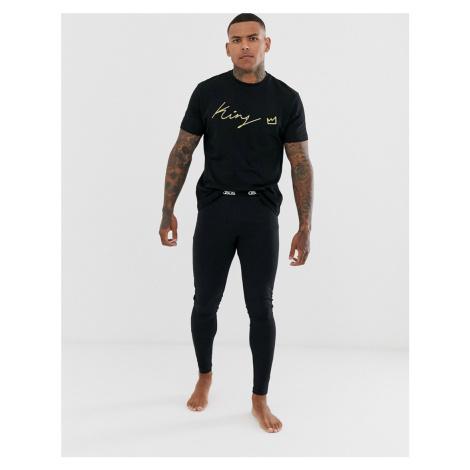 ASOS DESIGN lounge megging and tshirt pyjama set with slogan in black