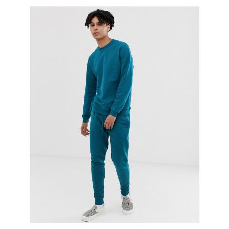 ASOS DESIGN tracksuit sweatshirt/skinny joggers in dark blue
