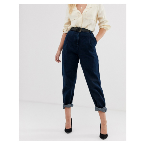 ASOS DESIGN tapered boyfriend jeans with curved seams and belt in indigo wash
