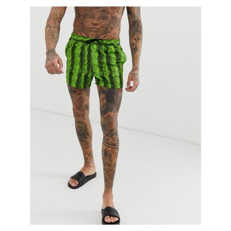 ASOS DESIGN swim short with neon green snake print in short length