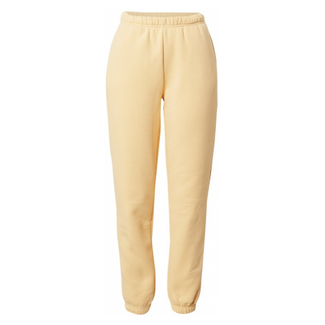 Gina Tricot Spodnie pastelowo-żółty