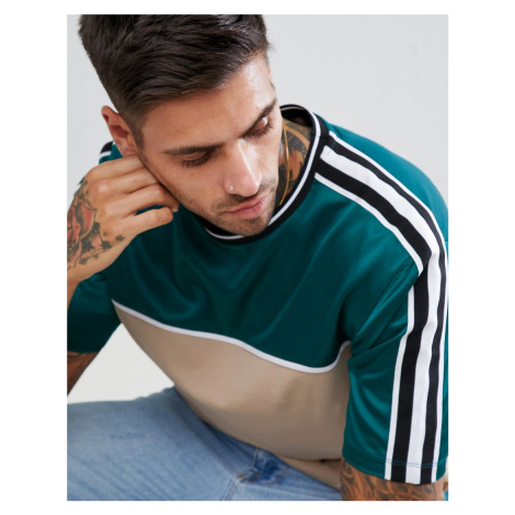 ASOS DESIGN longline t-shirt with contrast satin yoke and sleeve taping