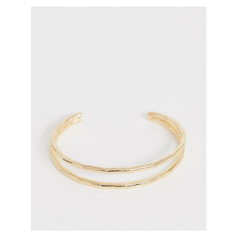 ASOS DESIGN cuff bracelet in double row engraved twist design in gold tone