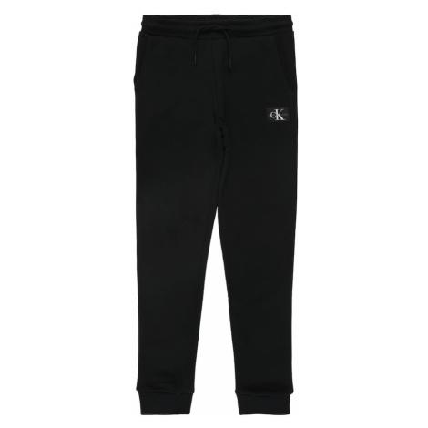 Calvin Klein Jeans Spodnie 'MONOGRAM SWEATPANTS, BAE, 16' czarny