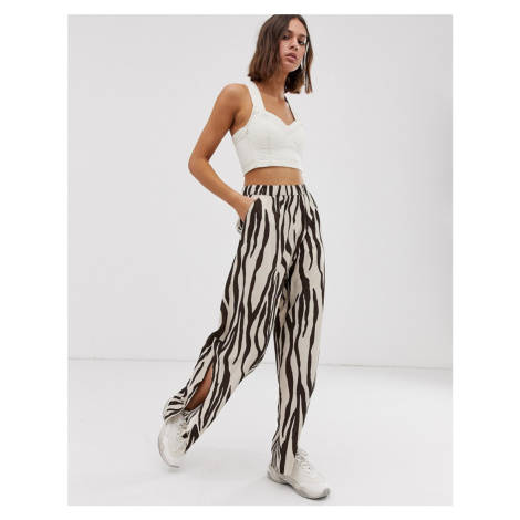 Weekday wide leg zebra print trousers with side slits in beige