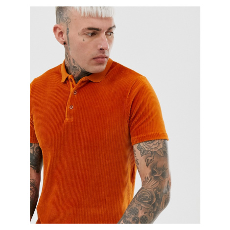 ASOS DESIGN longline polo shirt in ribbed velour in rust